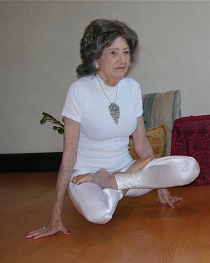 Senior Tao Porchon practicing yoga